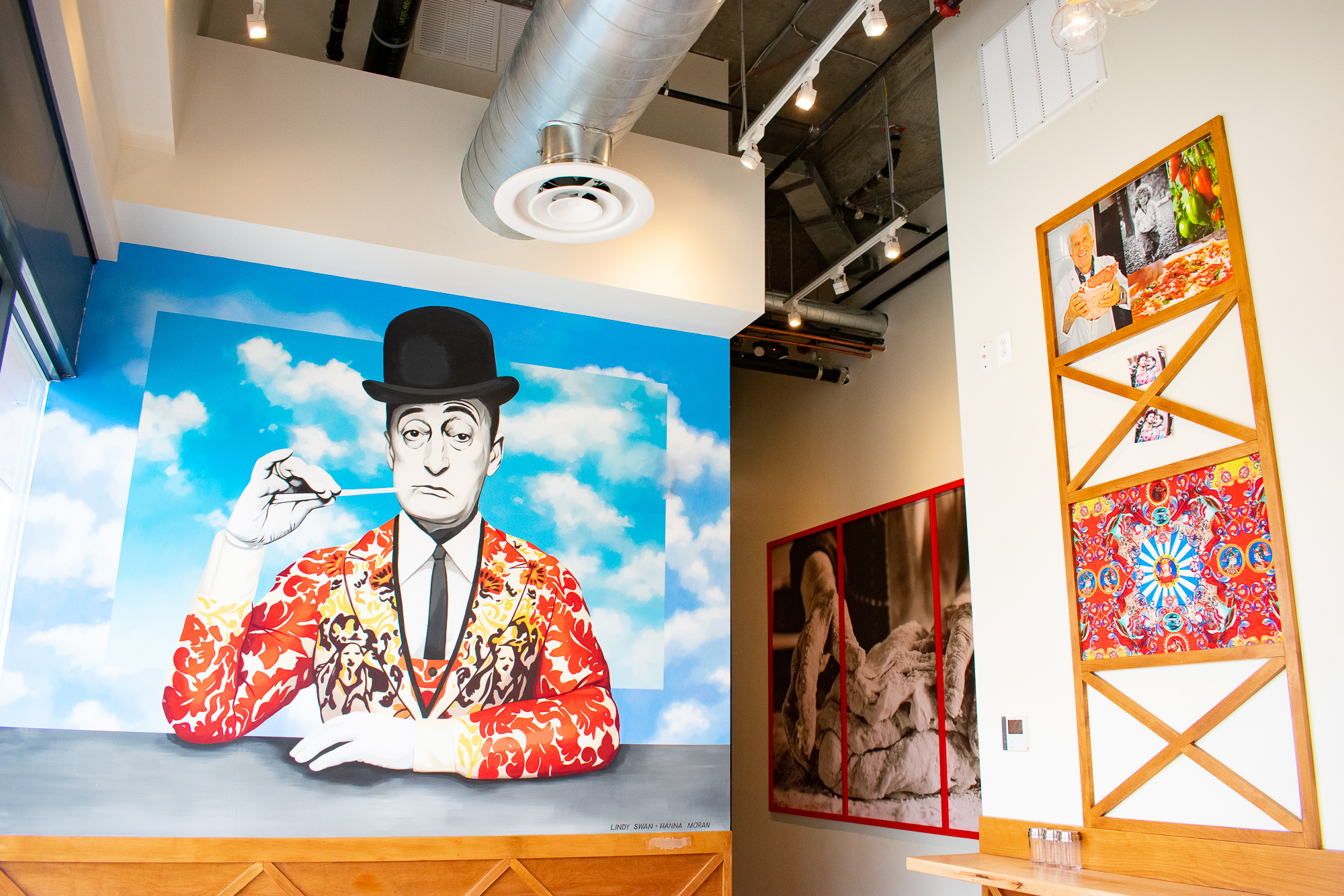 A painting of Italian comedian Totò in a Dolce & Gabbana jacket adorns the wall. Photograph by Meaghan Webster.