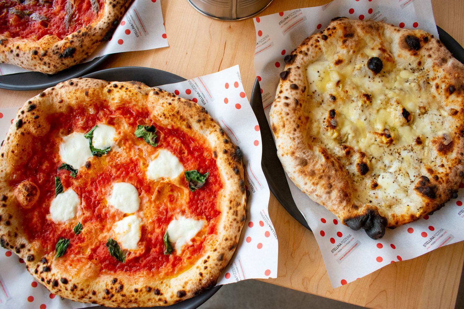 Margarita pizza and cacio e pepe pizza is made in the neo-Neapolitan style. Photograph by Meaghan Webster.