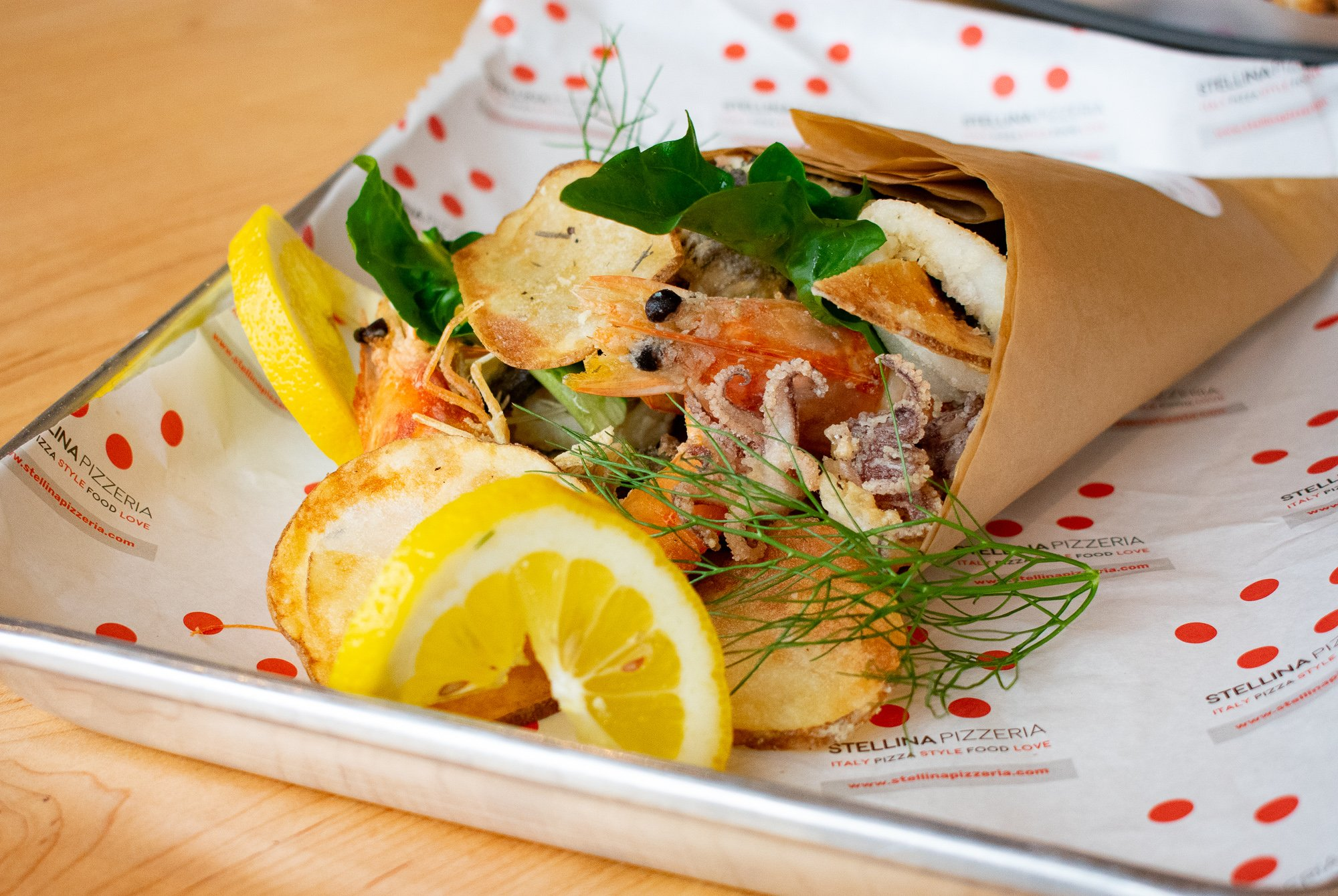 Seafood fritto misto is served in a paper cuoppo, inspired by Venini's trip to Puglia. Photograph by Meaghan Webster.