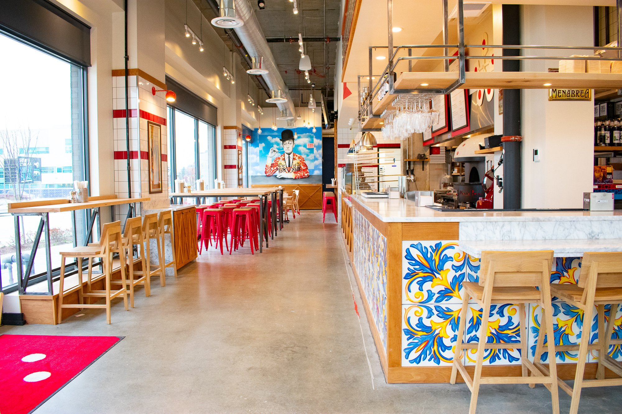 The red and white decor is reminiscent of pizzerias in Naples while the blue and yellow tiling calls to Matarazzo's connection to the Amalfi Coast. Photograph by Meaghan Webster.