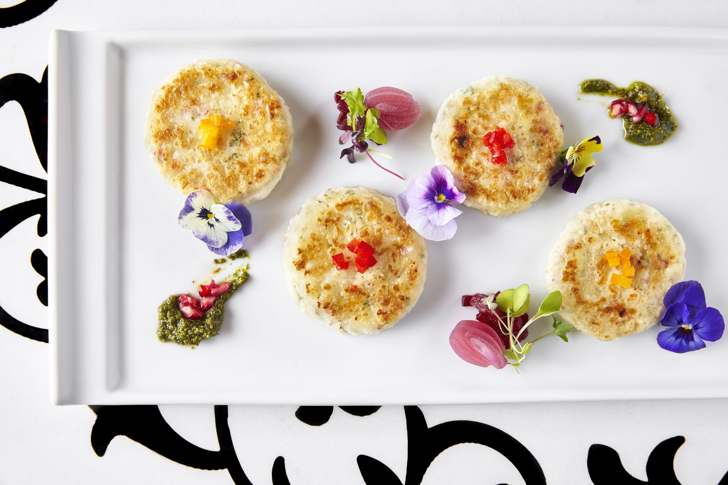 Pan fried Dahi Ke Kebab is a hot appetizer with mint and pomegranate dip. Photograph by Greg Powers.