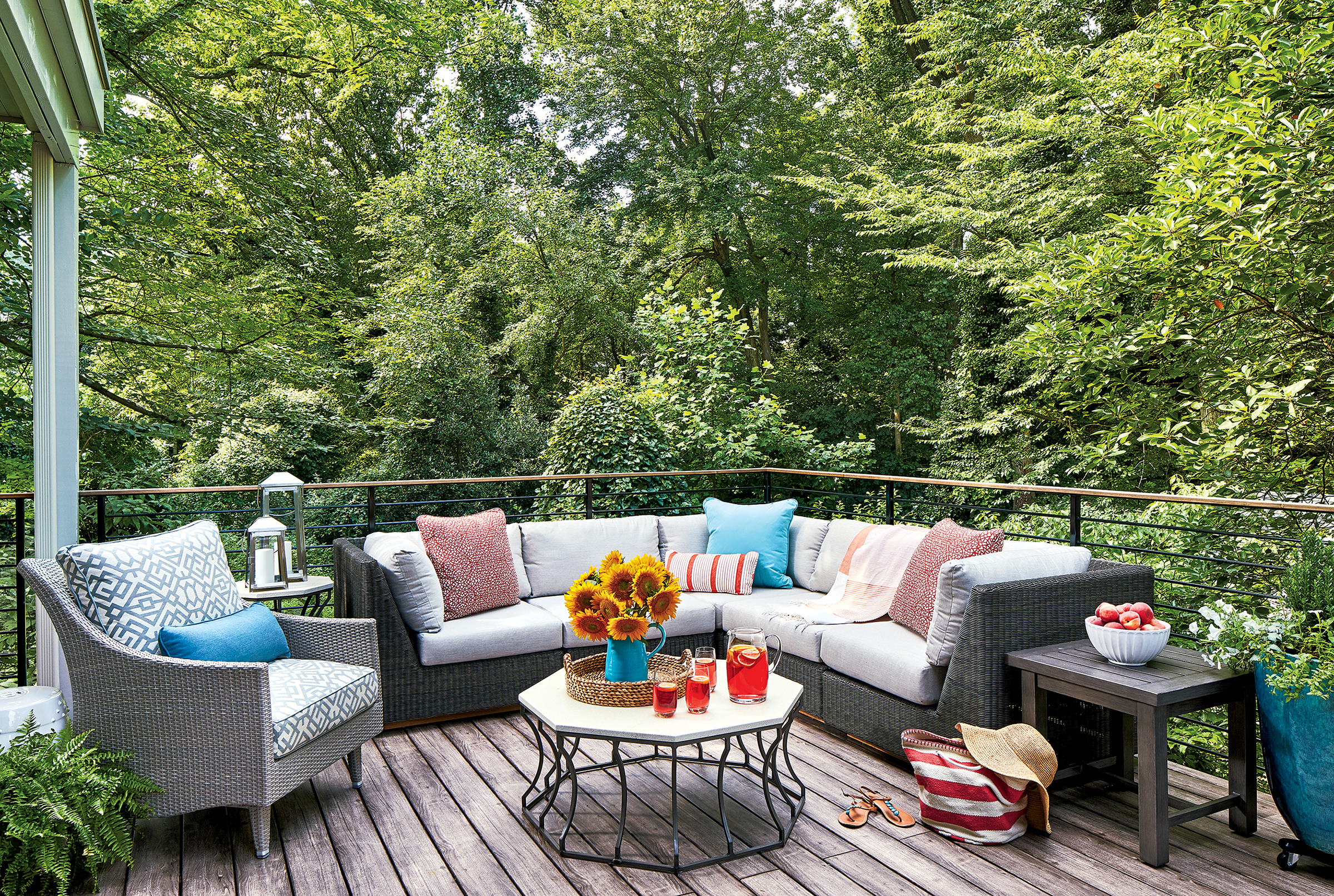 Durable pieces, such as weather-resistant wicker furniture, keep this deck both practical and stylish. Photograph by Stacy Zarin Goldberg.