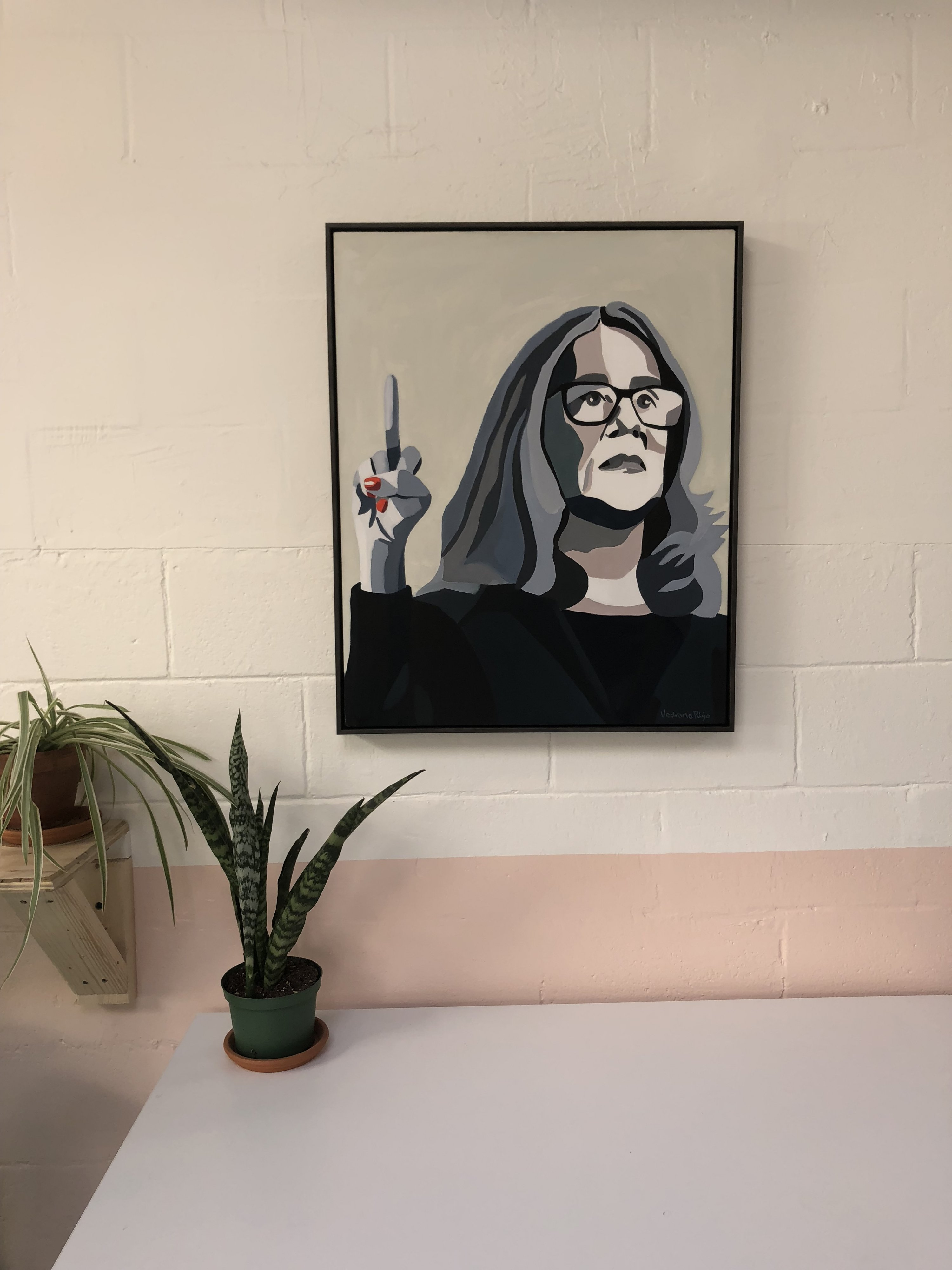 A painting of Christine Blasey Ford hangs on the wall.