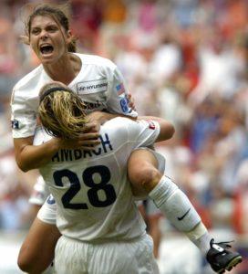 Mia Hamm in 2003, celebrating her goal for the Washington Freedom. AP Photo/Lawrence Jackson.