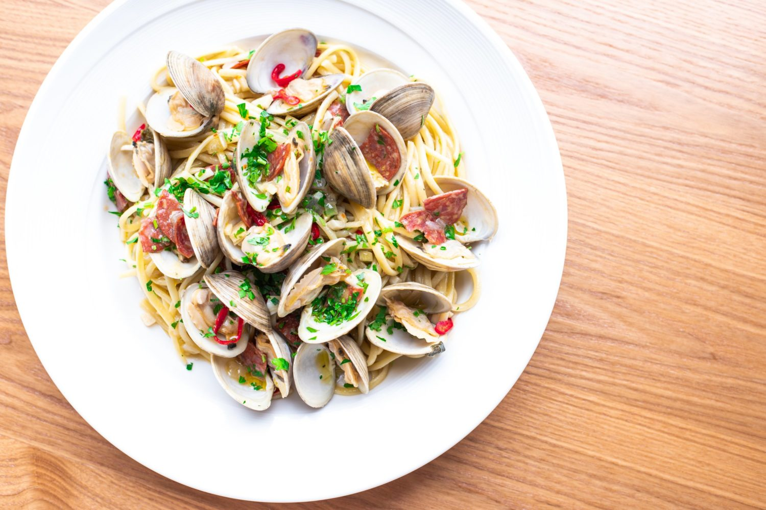Pasta is handmade daily and topped with ingredients like clams or springy ramps. Photograph by Kelli Scott.