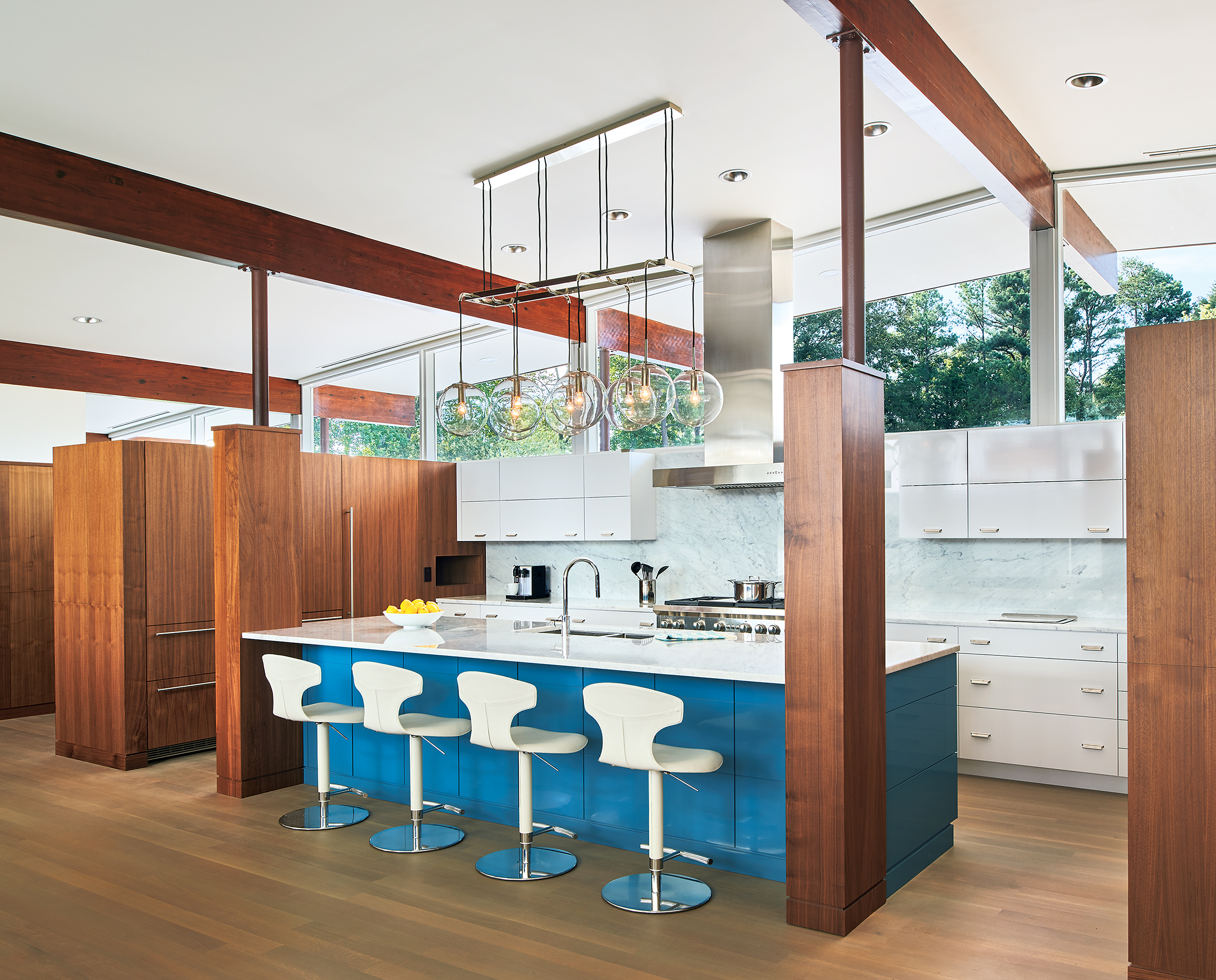 The owner chose the bold blue color of the island in the renovated kitchen.