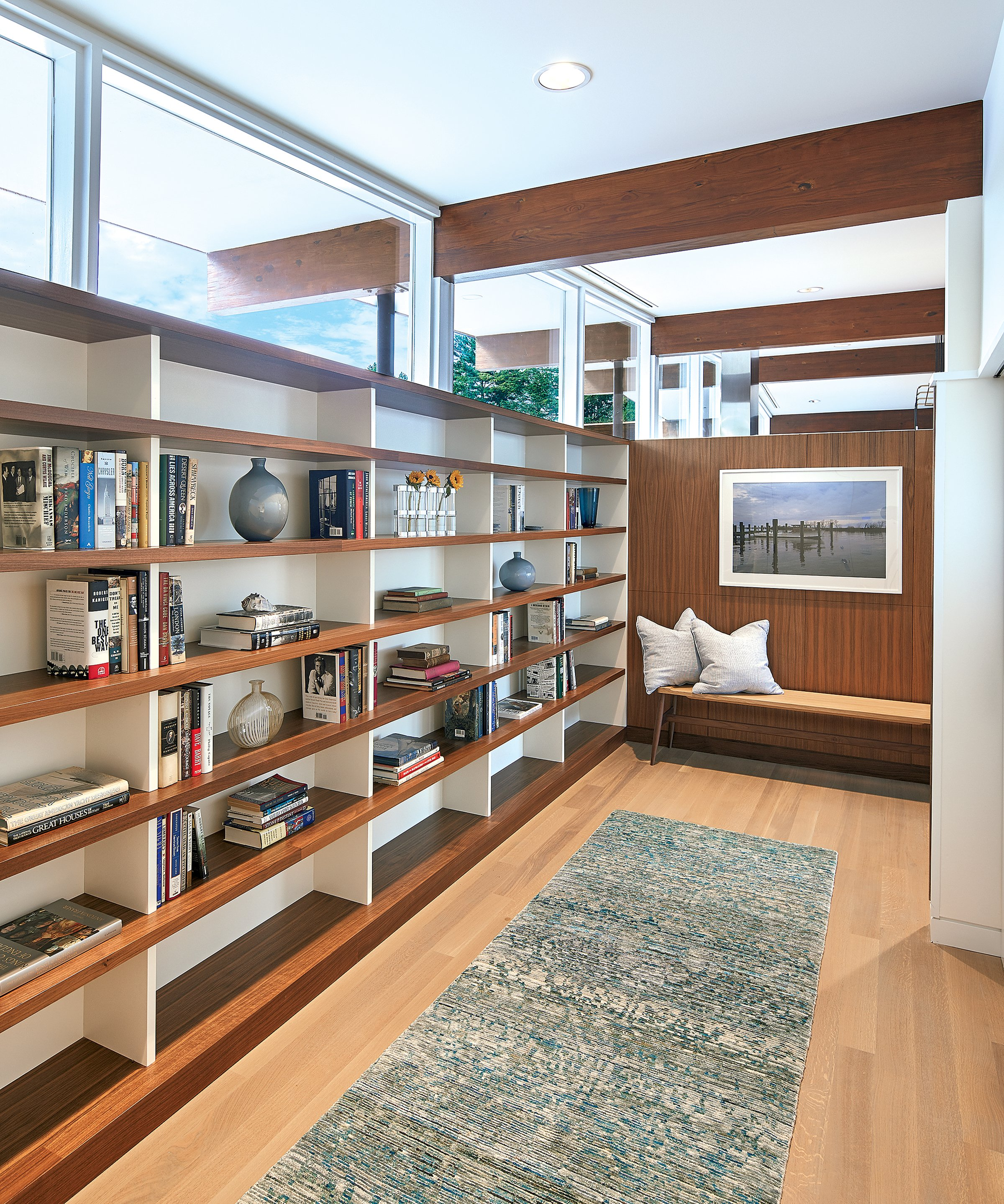 The architects added built-in shelves to the entryway, further emphasizing the clerestory windows above them.
