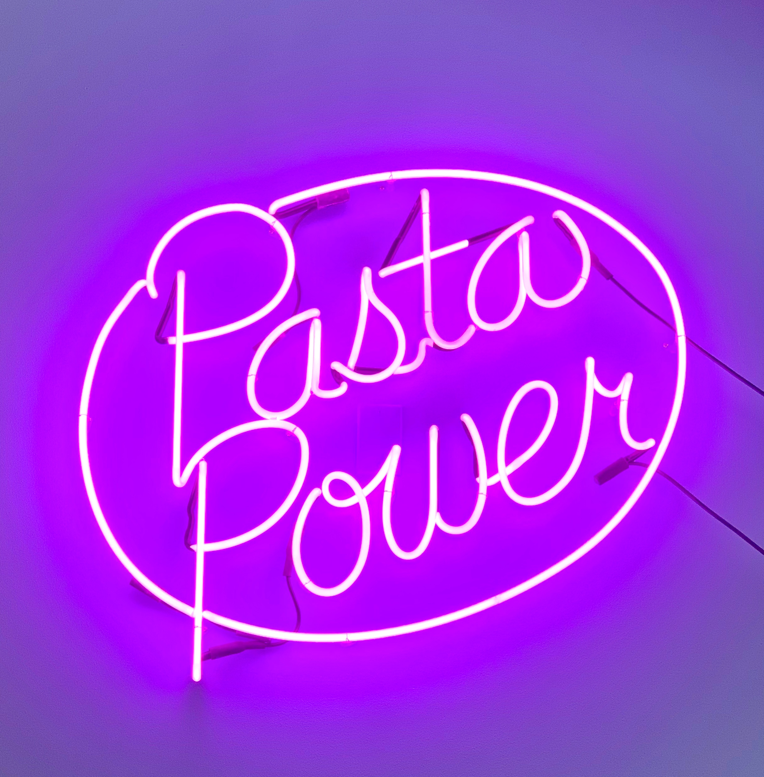 "A neon ""pasta power"" sign gives a hints at the menu offerings. Photograph courtesy of Thompson Italian."