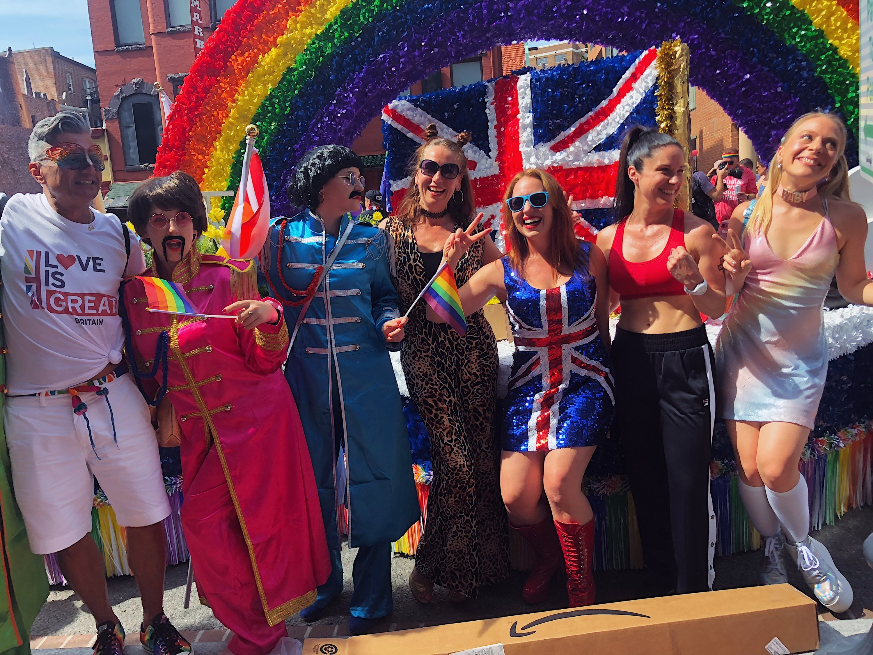 The Spice Girls and the Beatles pose in front of the float. Photograph by Daniella Byck.