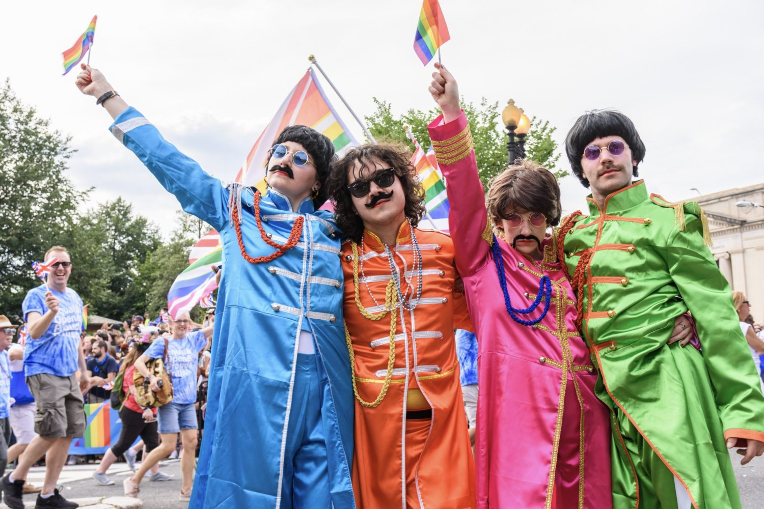 Embassy volunteers dressed as the Beatles wave rainbow flags during the Capital Pride Parade. Photo by Scott Marder.