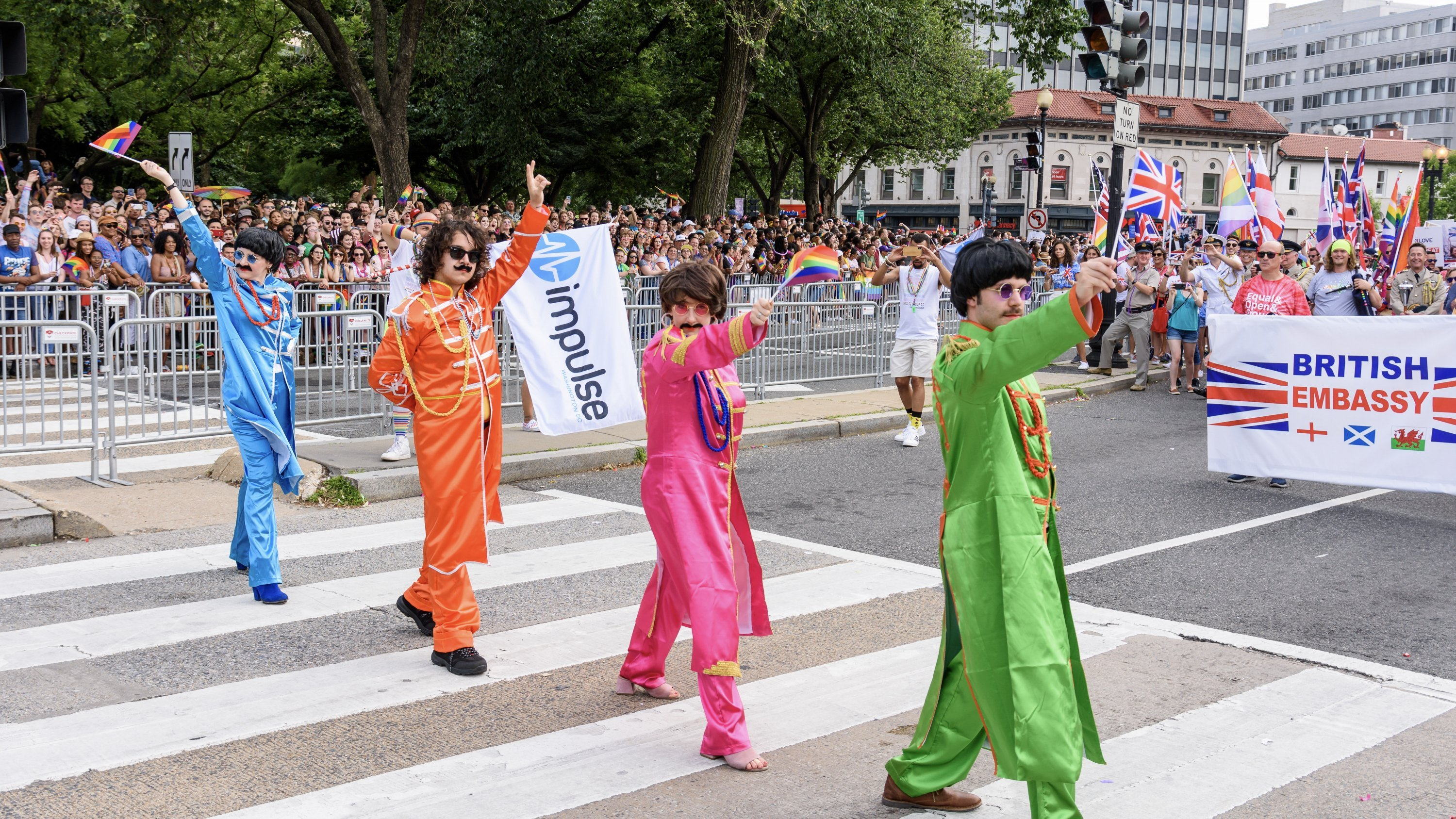 Volunteers dressed as the Beatles pay homage to Abbey Road during the Capital Pride Parade. Photograph by Scott Marder.