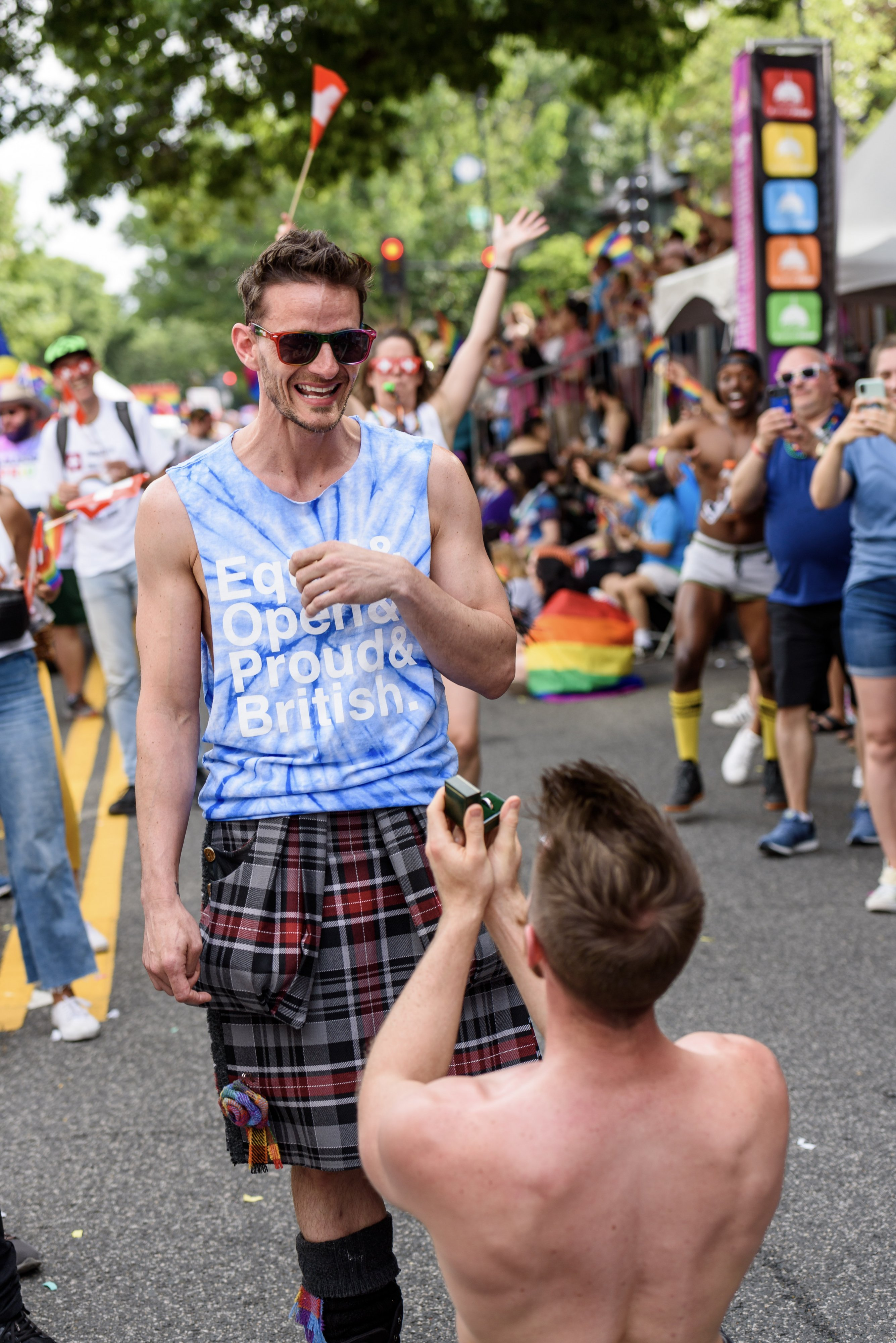 Finley Wilson proposes to Alan Lambie during the parade. Photograph by Scott Marder.