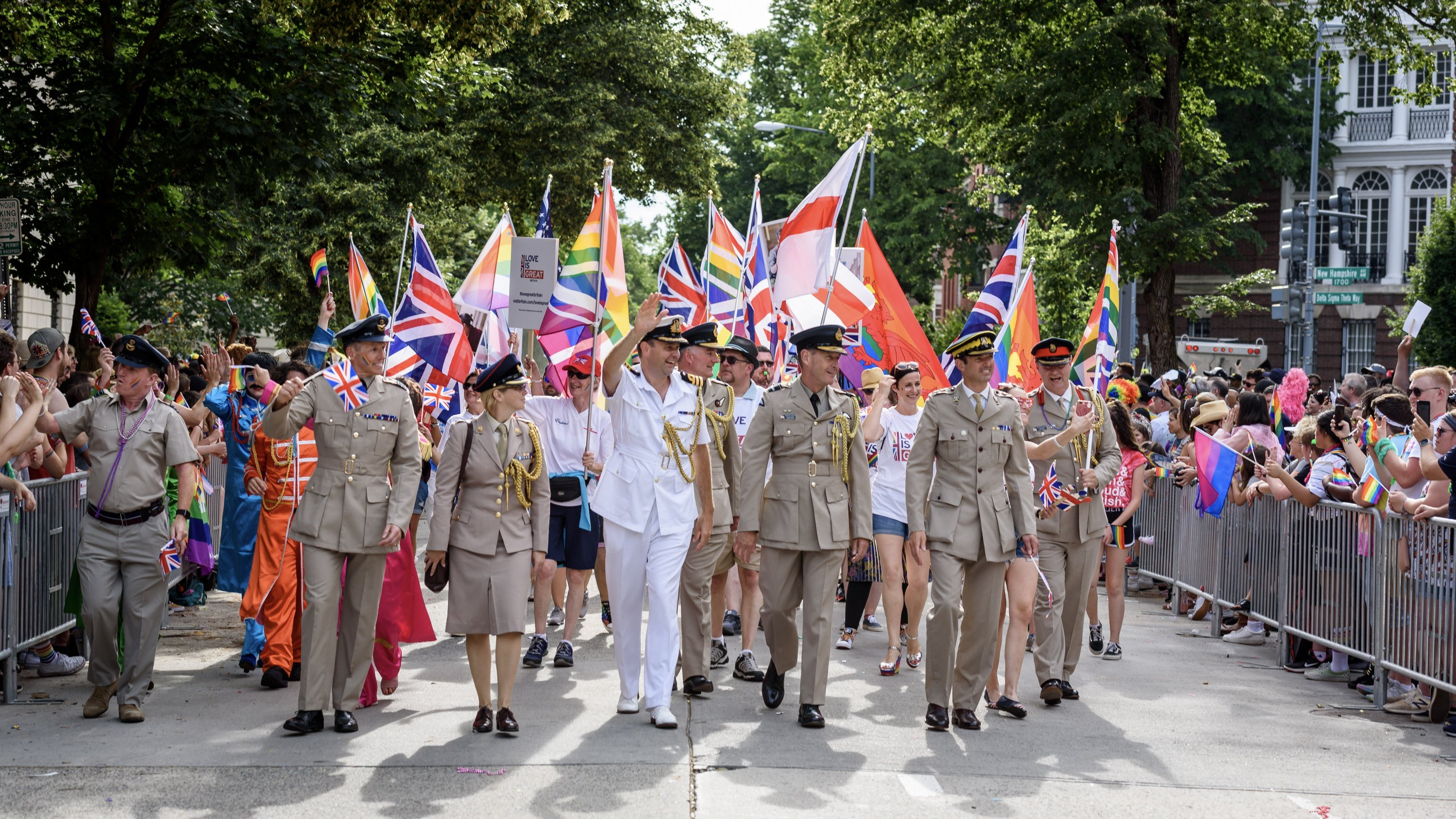 Clad in military uniforms, embassy staff waved rainbow Union Jack flags. Photograph by Scott Marder.