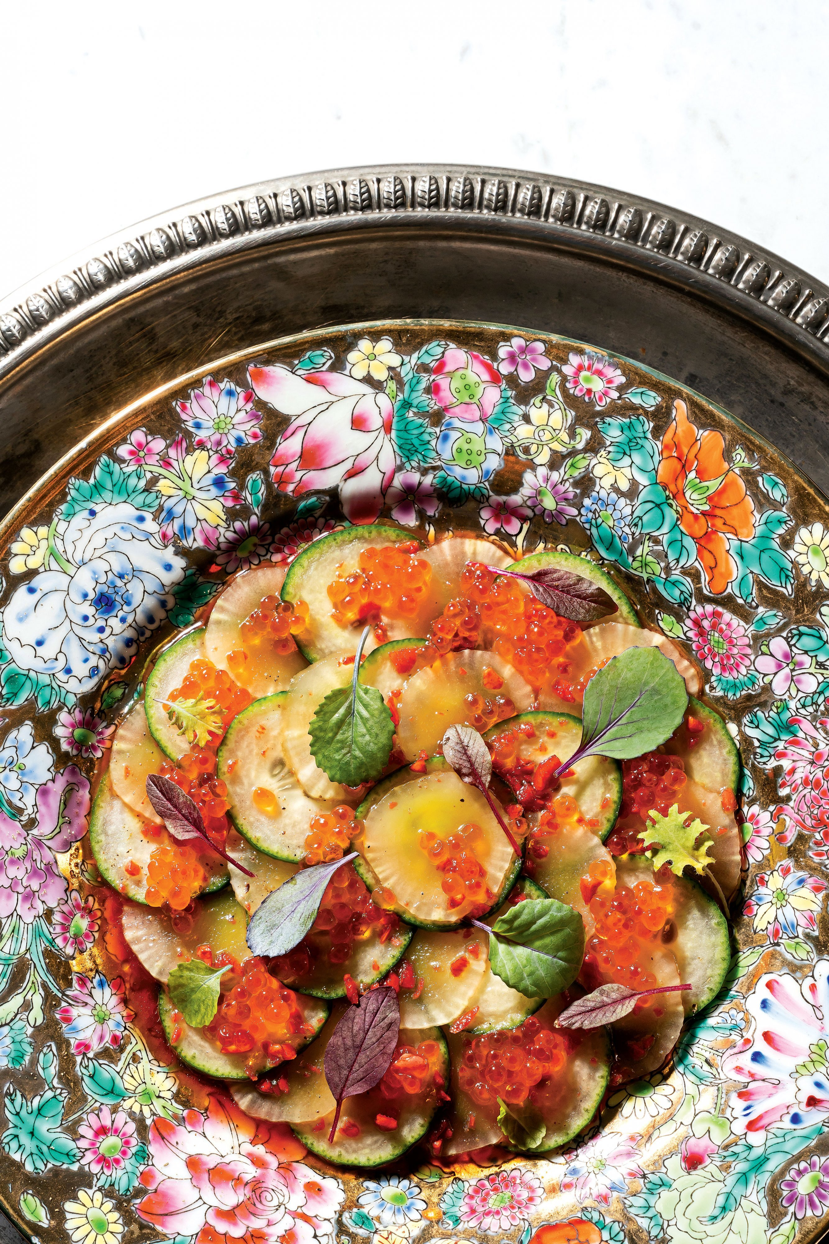 Cheung's version of a cucumber salad made with sesame oil and red vinegar, then strewn with flower petals. Photograph by Scott Suchman.
