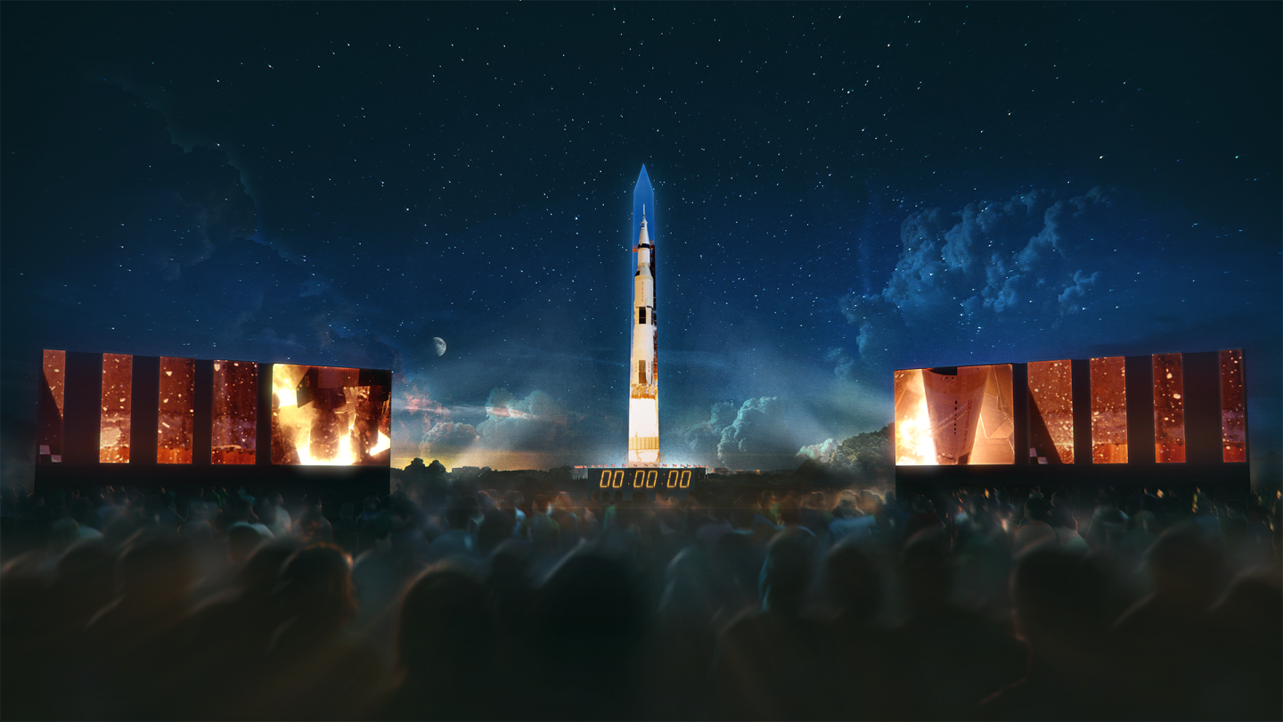 The Washington Monument transforms into the Saturn V rocket for a show depicting the lunar mission. Image courtesy of the National Air and Space Museum.