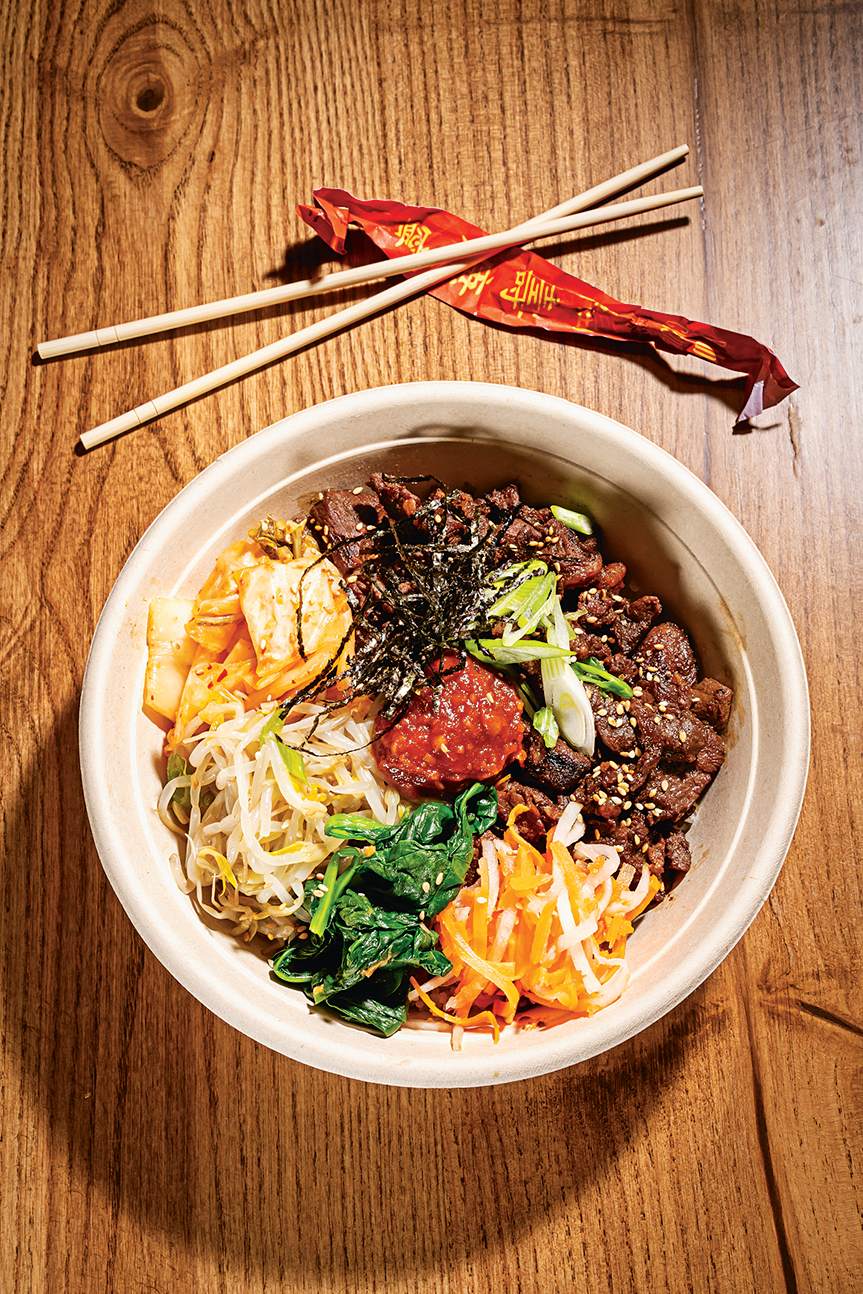 Rice Crook's Korean barbecue-beef bowl topped with kimchee, bean sprouts, and pickled daikon and carrot.