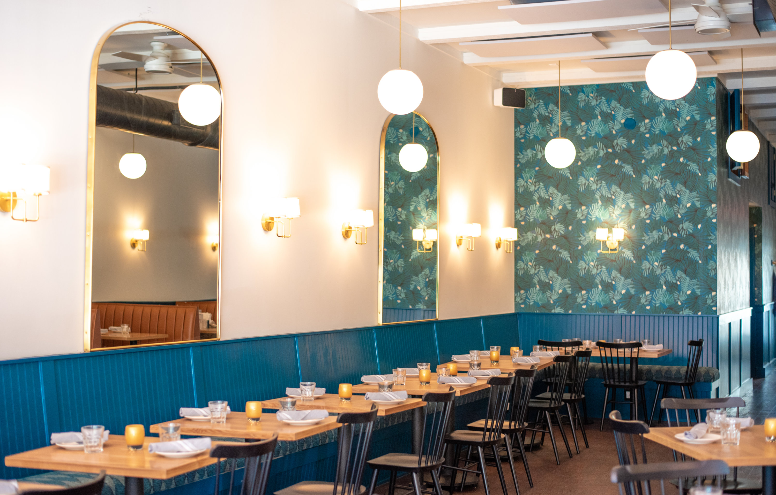 Touches of teal are inspired by L'Artusi. Photograph courtesy of Thompson Italian.
