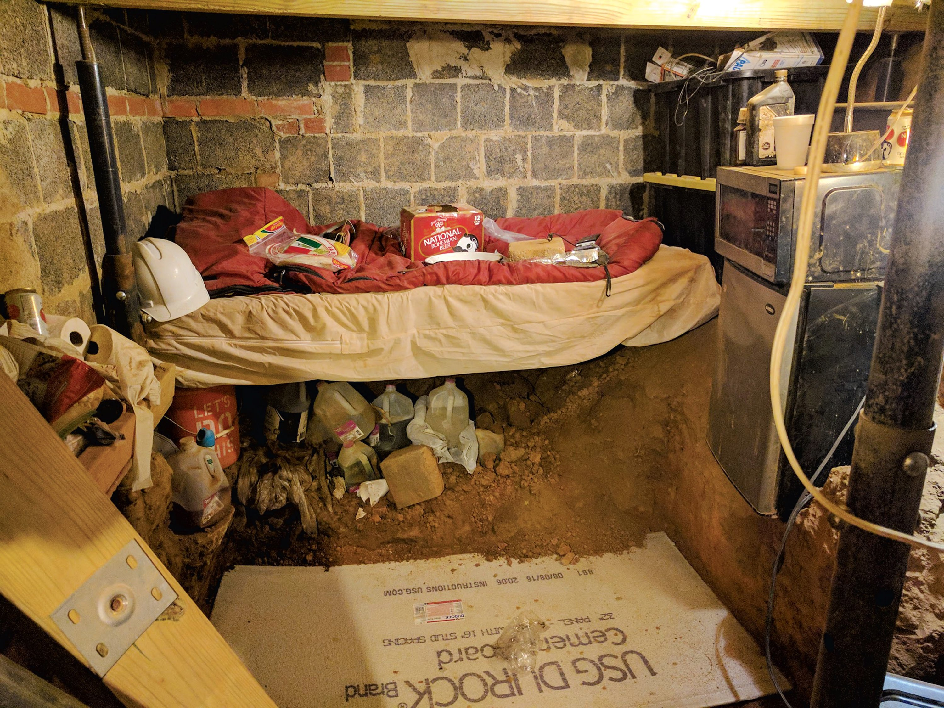 Askia would dig in the fallout shelter for days a time. His bedroom had a microwave and mini-fridge. Daniel would throw food down to him. Photograph Courtesy of Montgomery County Circuit Court.