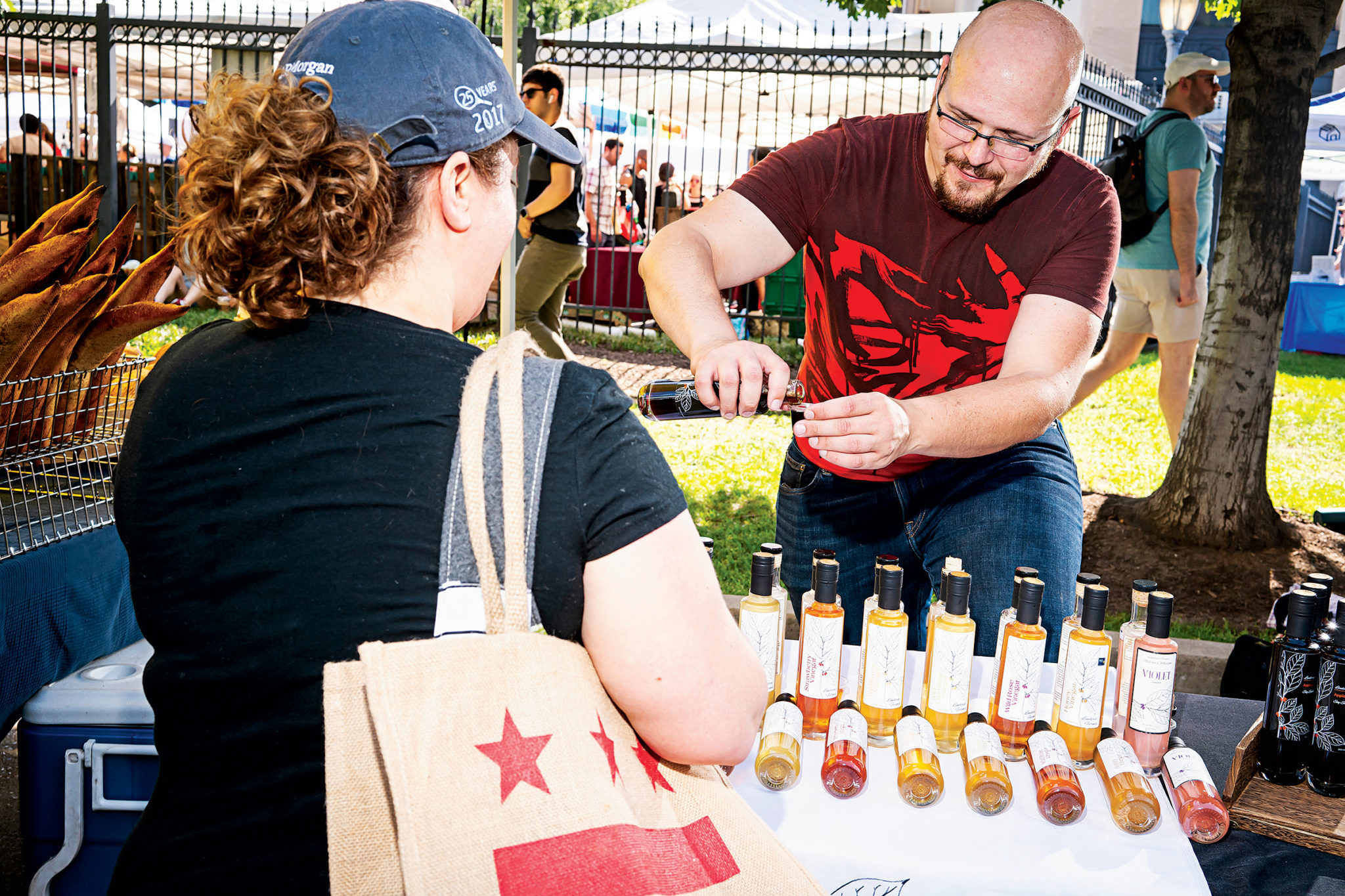 Daniel Liberson of Lindera Farm's sells vinager and soy sauce at the Dupont Circle Farmers market.