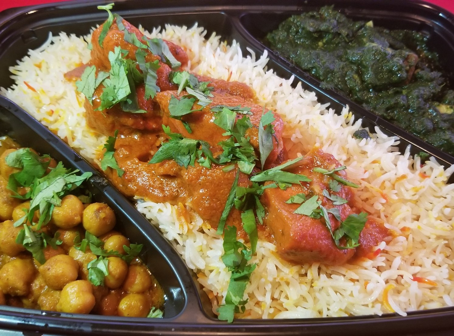 Each $11 platter comes with butter chicken and two side dishes. Photo courtesy of Butter Chicken Company.