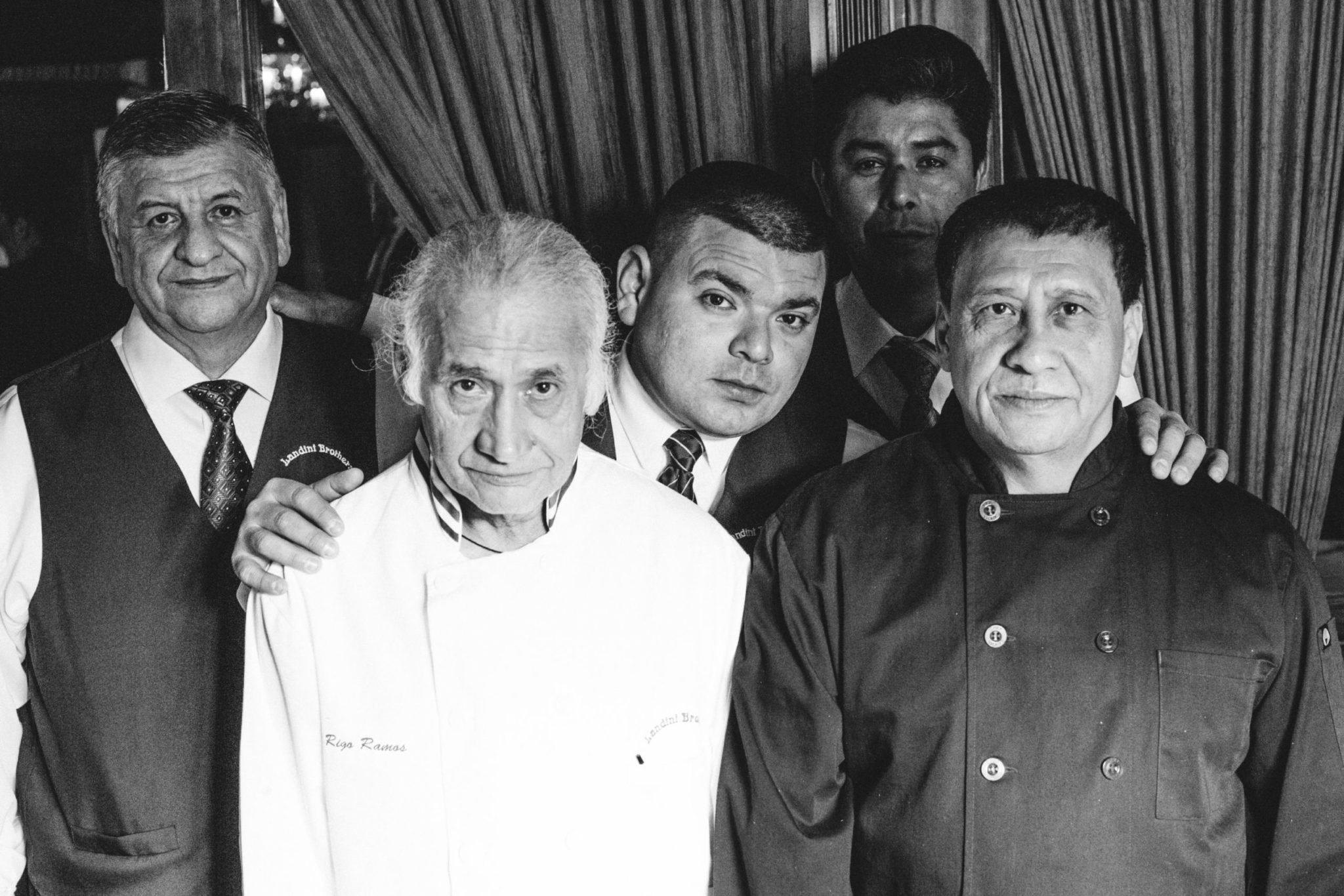 Chef Rigoberto Ramos, pictured with Landini Brothers staff, is celebrating 40 years with the 40 year old restaurant. Photo by Maya Oren/MOJALVO.