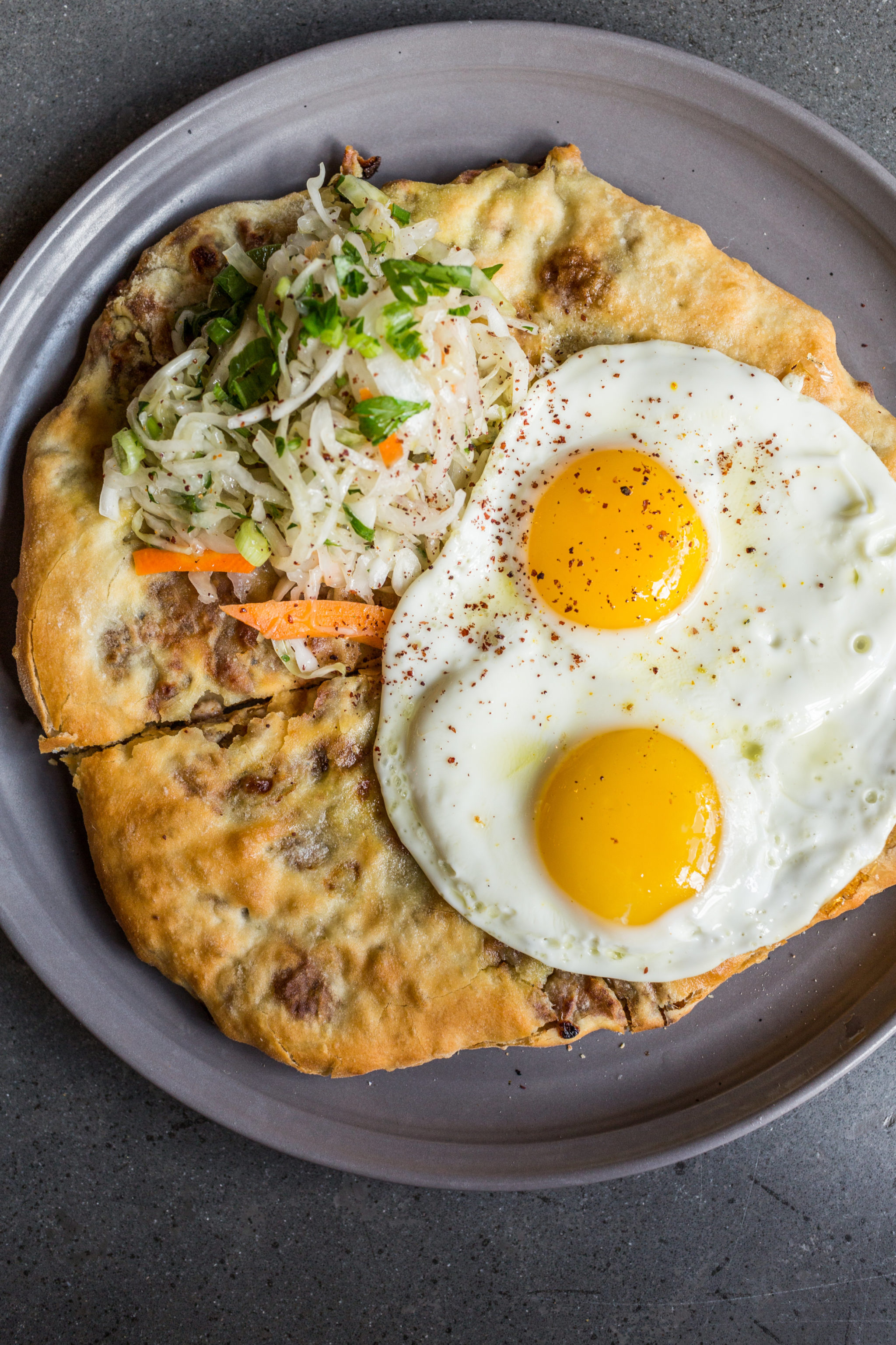 Potato-and-cheese-stuffed khabizgina is topped with an egg at Supra. Photo courtesy of Supra.
