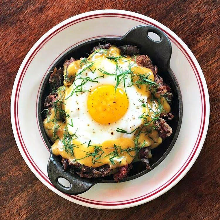 Duck confit is topped with an egg at Le Diplomate. Photo courtesy of Le Diplomate.