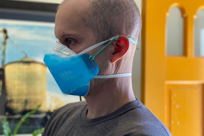 Jeremy Filko wears a 3D-printed shield over a mask. Photo courtesy of Amy and Jeremy Filko.