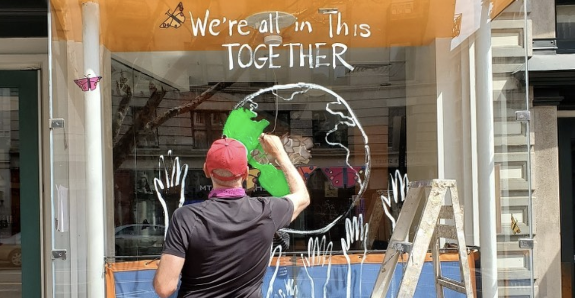 Instead of Boarding Up, Businesses Are Painting Their Storefronts With Uplifting Messages