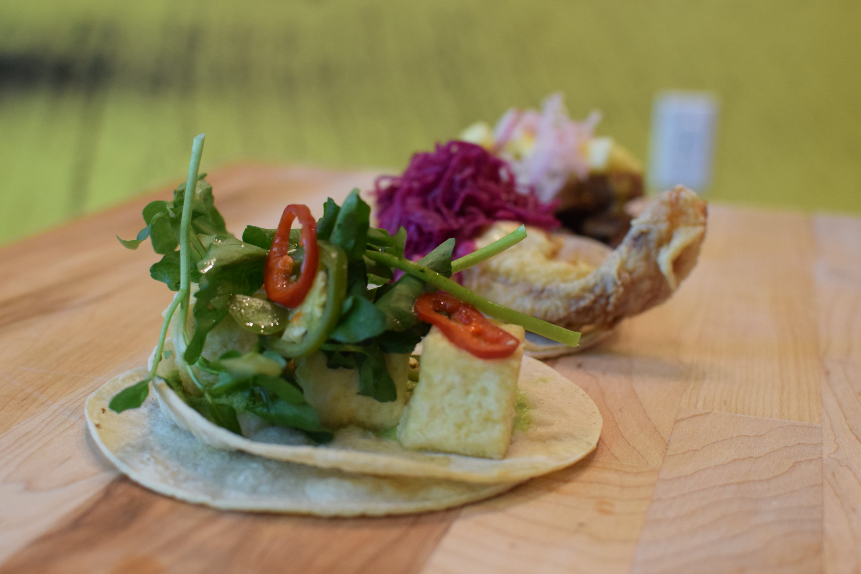 A masa tofu taco with watercress. Photo courtesy of Taco and Piña.