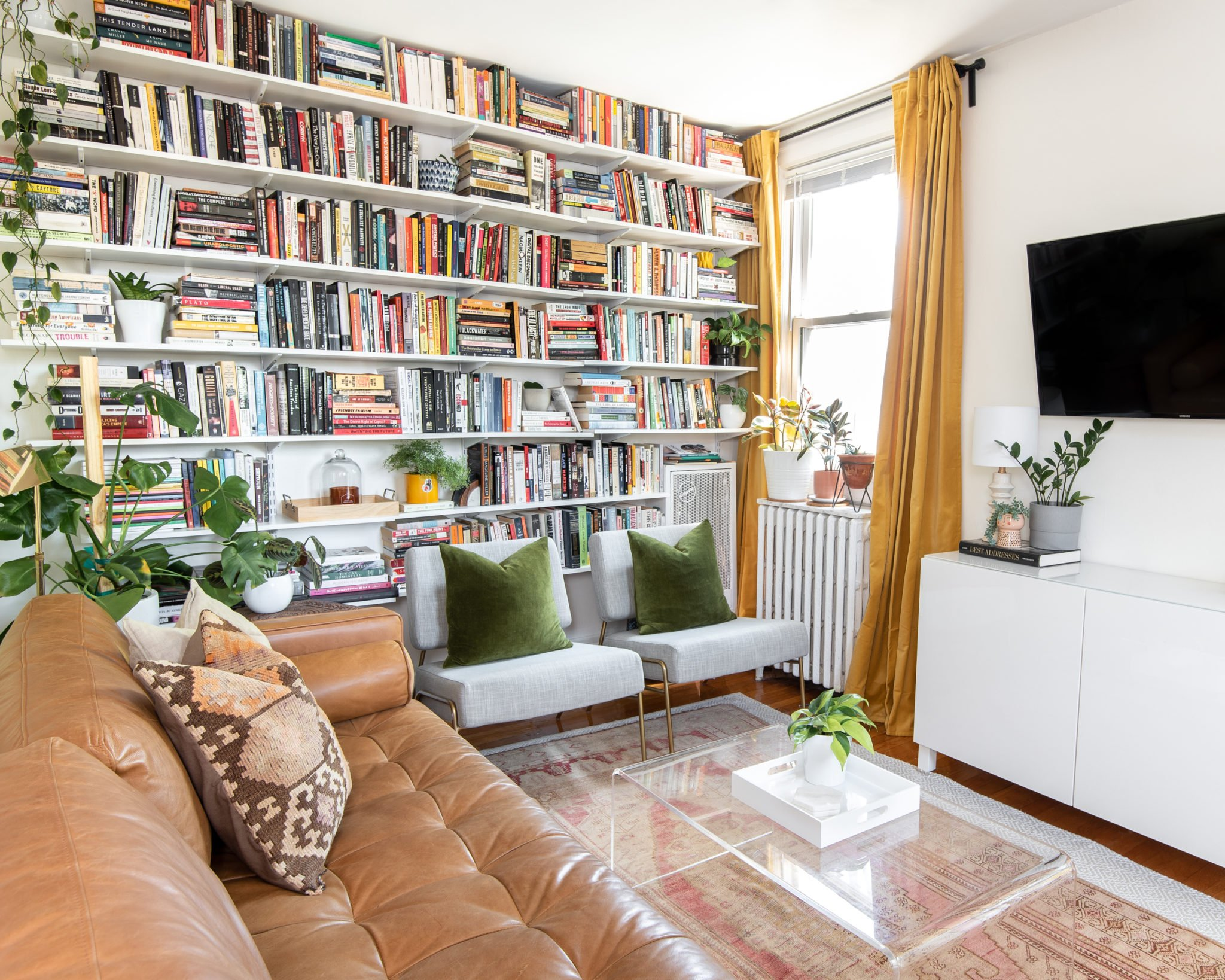 Look Inside My Home: A Park View One-Bedroom With a Floor-to-Ceiling Bookshelf, Statement Wallpaper, and Tons of Plants