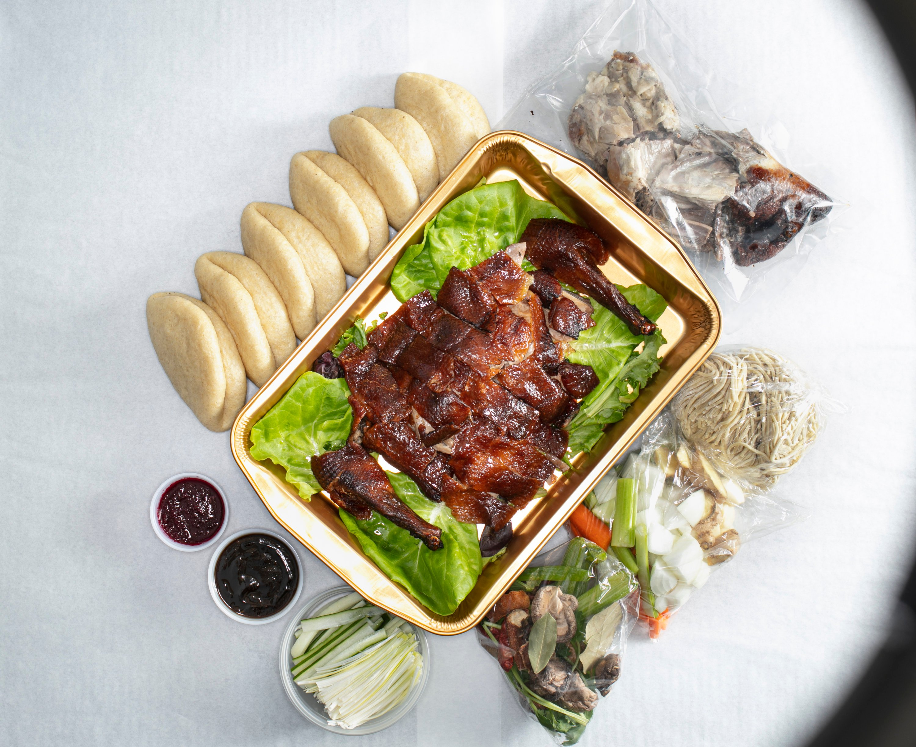Peking duck kits arrive with buns and housemade noodles. Photo by Melissa Hom.