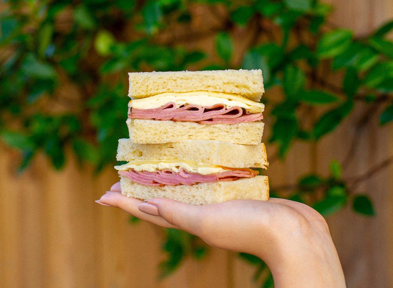 A ham, cheese, and butter sando on milk bread. Photo courtesy of Hello Sando.
