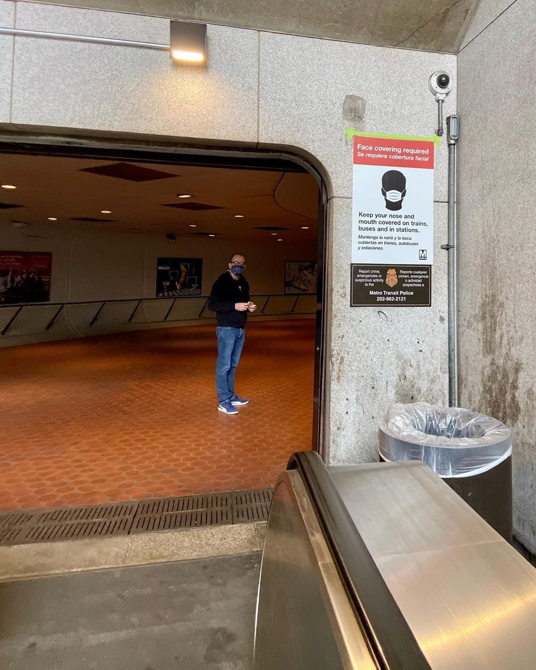"""A """"face covering required"""" sign at the Eastern Market Metro. Photo courtesy of DC Public Library."""