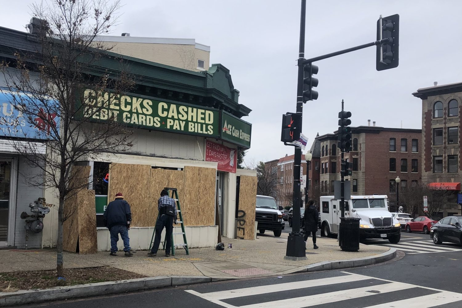 A boarded-up shop in Adams Morgan. Photo by Anna Spiegel.