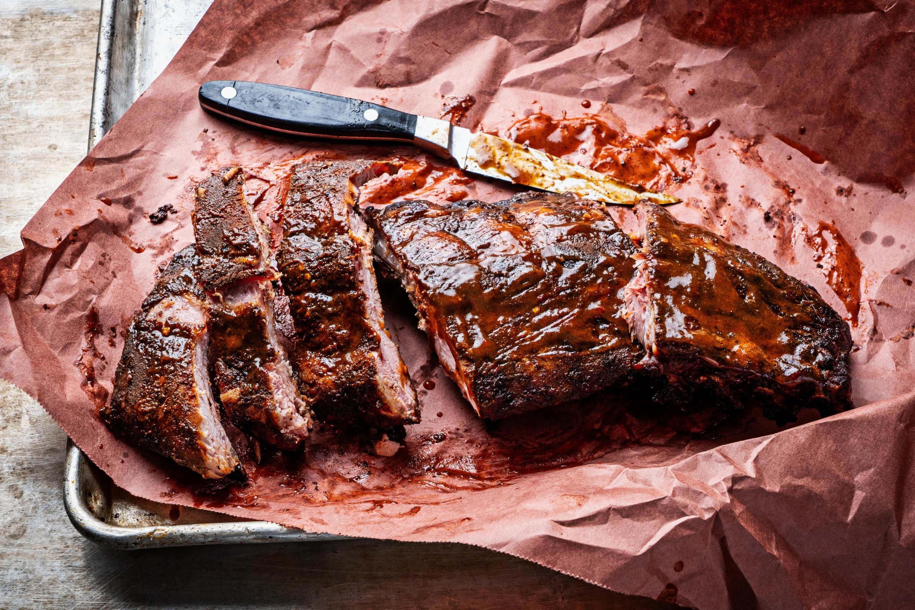 Money Muscle BBQ is serving barbecue samplers on game day. Photo courtesy of Money Muscle BBQ.