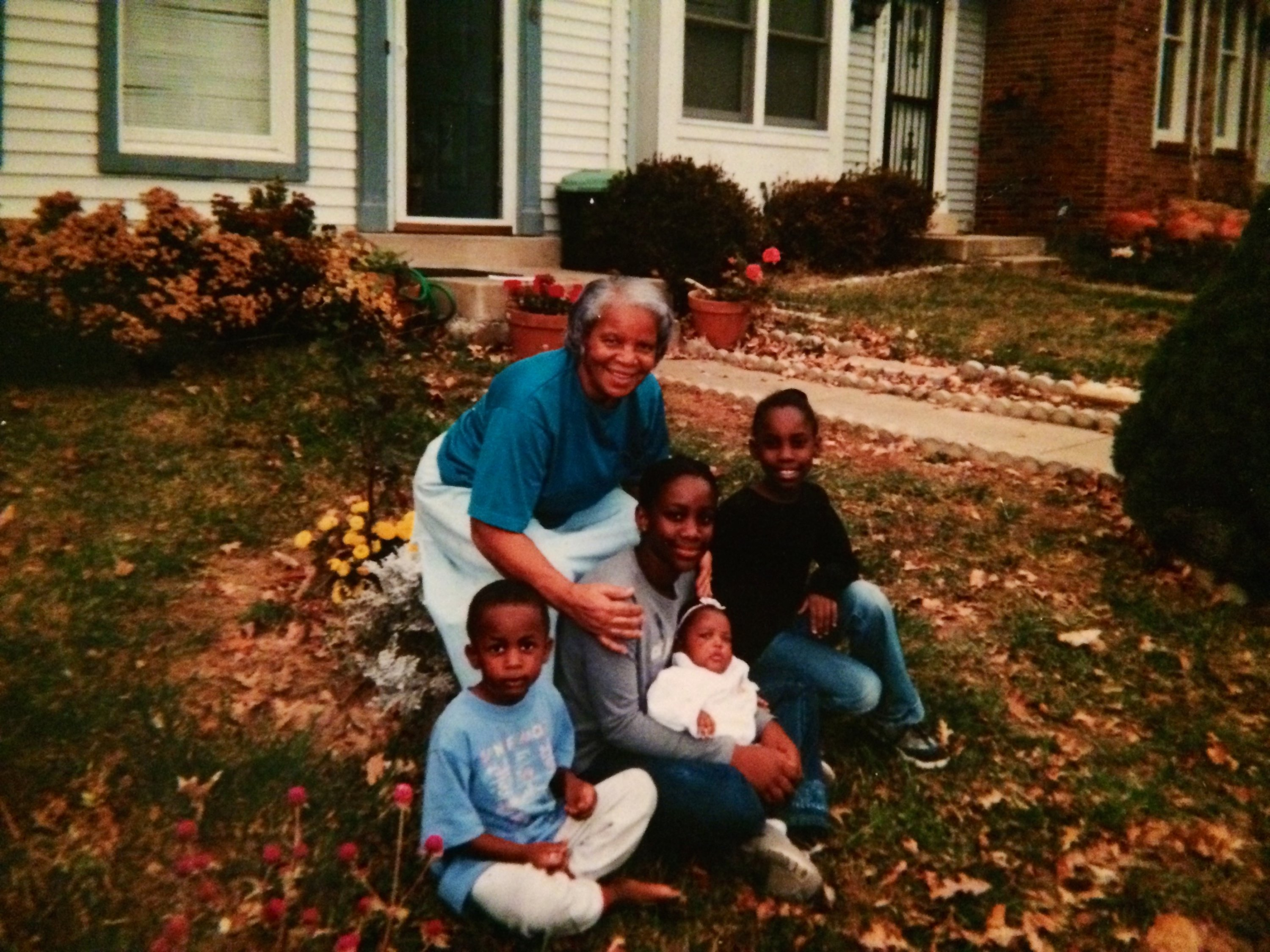 An undated photo of Phillip (holding the baby) with her brother, sisters, and grandmother.