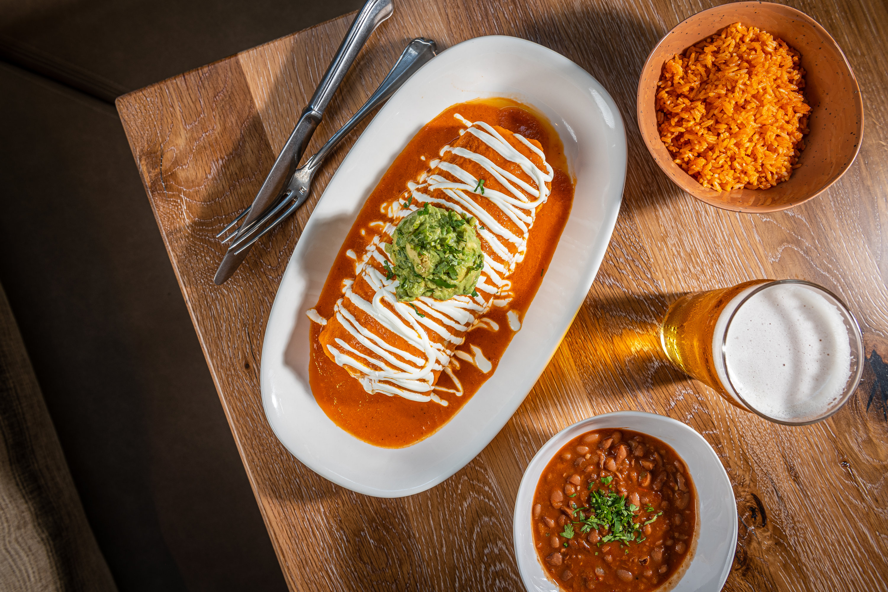 Burritos are layered with ranchero sauce. Photo by Rey Lopez.