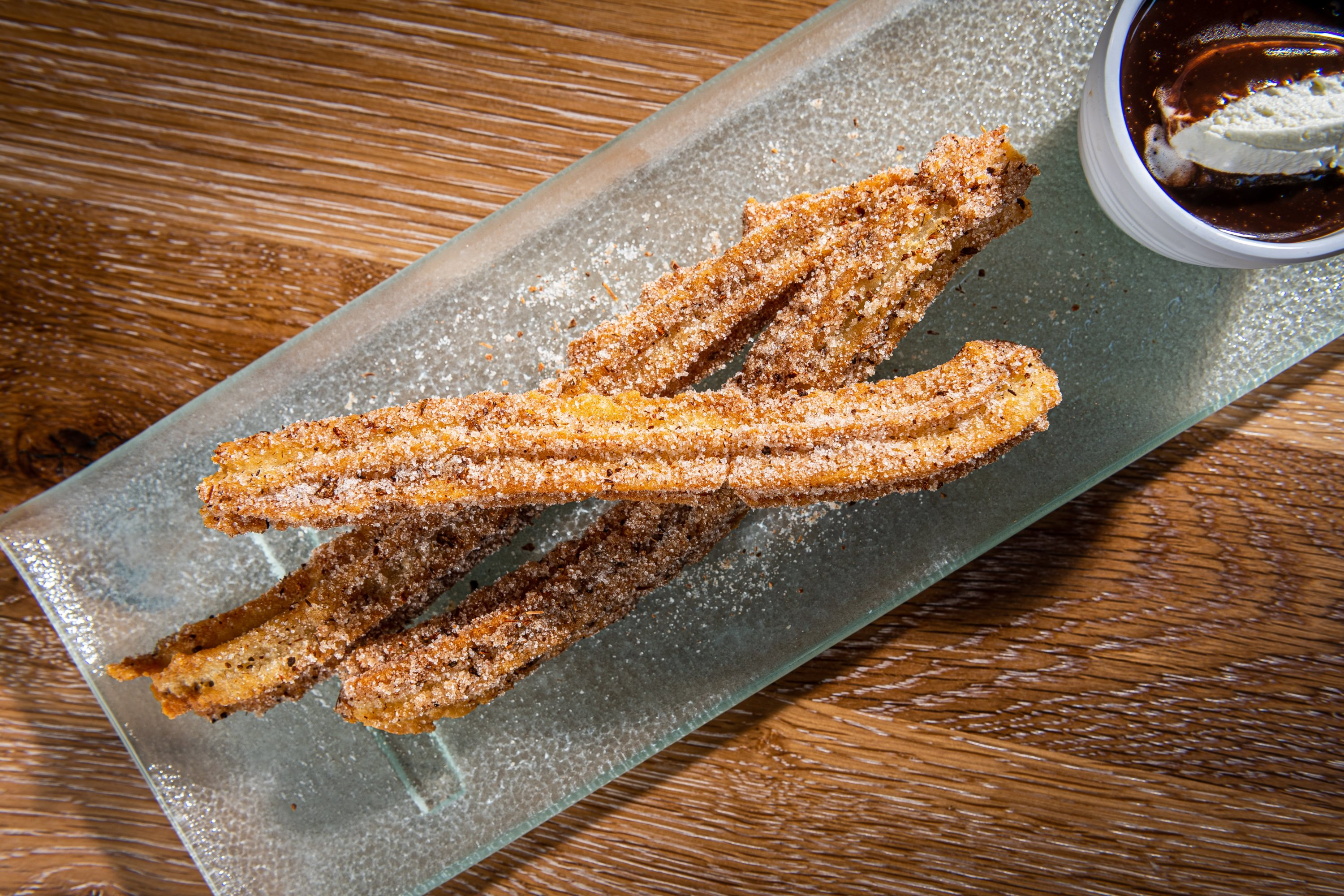 Flan and churros are on the dessert menu. Photo by Rey Lopez.
