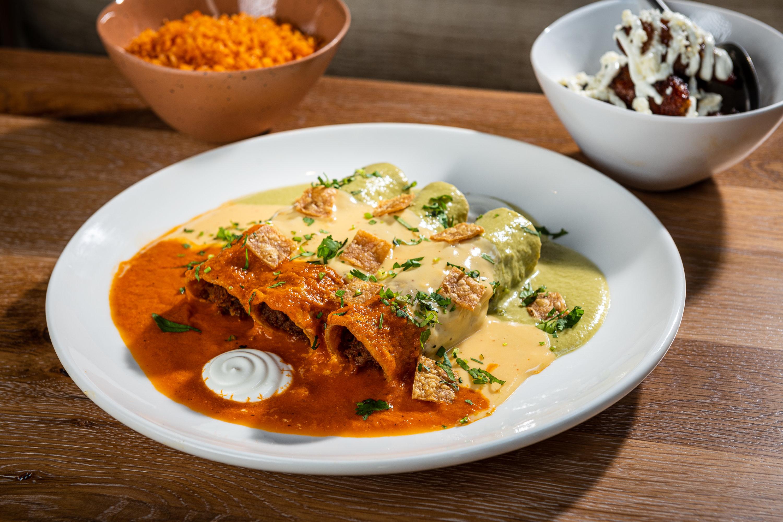 Tri-color enchiladas. Photo by Rey Lopez.
