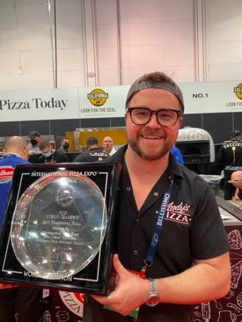 Andy Brown with his International Pizza Challenge trophy. Photo courtesy of Andy's Pizza.