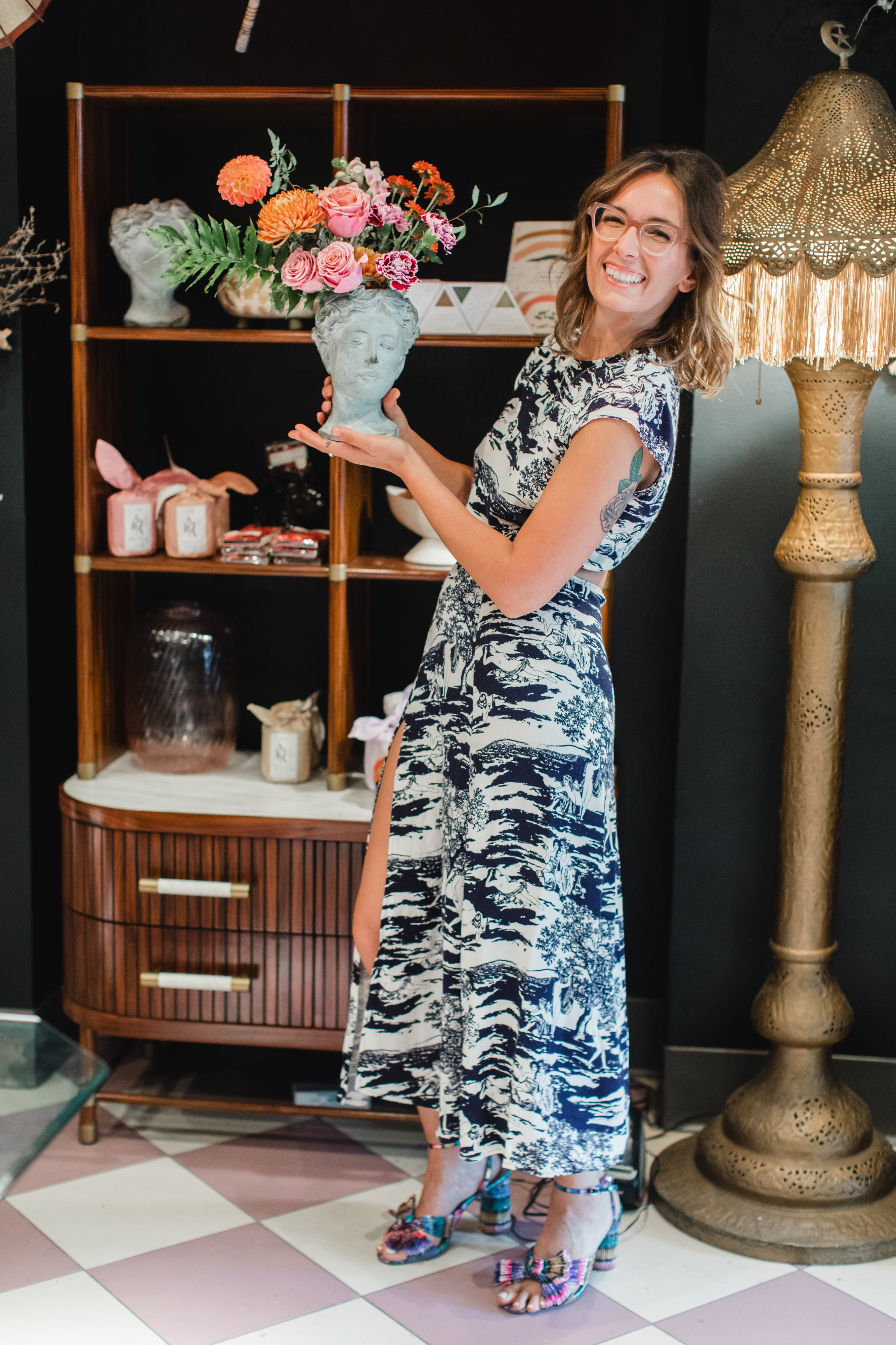 She Loves Me Owner Holley Simmons with the Aphrodite vessel. Photo by Maddie Kaye Photo.
