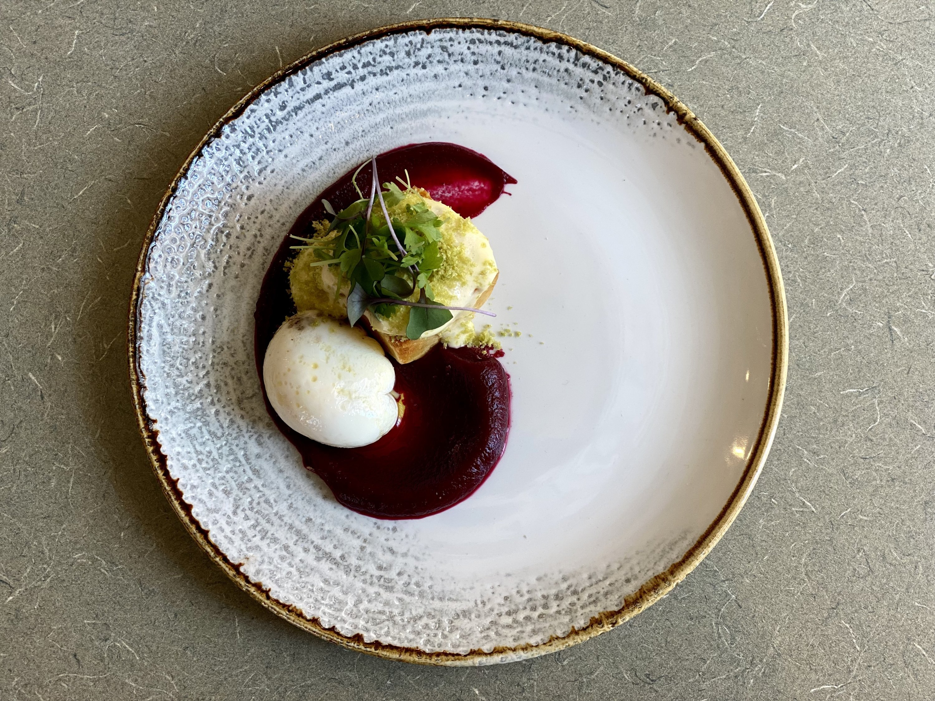 The Russian salad is garnished with beets and potatoes.  Photo courtesy of Immigrant Food.
